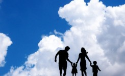 family in the blue sky background.